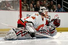 Miikka Kiprusoff Photos - Goalie Miikka Kiprusoff of the Calgary Flames stretches before a game against the Colorado Avalanche on March 2007 at the Pepsi Center in Denver, Colorado. The Avs won - Calgary Flames v Colorado Avalanche Hockey Goalie, Hockey Teams, Nhl, Bernie Parent, Goalie Mask, Colorado Avalanche, Calgary, The Incredibles, Baseball
