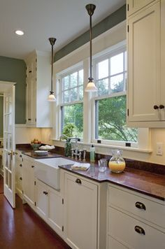 Bungalow kitchen with white cabinets and muted aqua walls - Craftsman Design and Renovation, craftsmandesign.com - Ekert and Ekert Photography