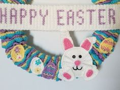 Crochet Easter Wreath with this free pattern that uses only easy stitches. The wreath is constructed of 3 long garlands, wrapped around a wire wreath frame Crochet Wreath, Easy Crochet, Free Crochet, Crochet Things, Octopus Crochet Pattern, Easter Crochet Patterns, Bunny Crafts, Easter Crafts For Kids, Wire Wreath Frame