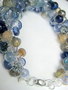 Many many many bubbles all in a shades of blue and silver color ways. (shown are 2 different colorways of the same necklace style. For scale purposes)