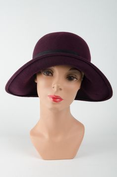 The Flora is a much admired formed-felt hat with its characteristic brim dipping down on both sides and a plain rounded crown. Fitted with a stretchy ribbon on the inside for comfort and trimmed with a thick band and vintage buckle. Colour: Wine with black band and vintage buckle. #Fabhatrix #Edinburgh #Grassmarket #Flora #formedfelt #hat Brown Band, Felt Hat, Edinburgh, Headpiece, Flora, Feather, Ribbon, Crown, Colour