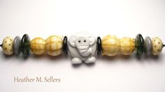 Working for Peanuts, an elephant inspired lampwork glass bead set by Heather Sellers Art Glass