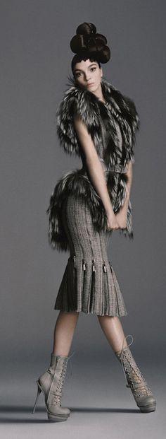 Italian model Mariacarla Boscono poses in Autumn-Winter 2011-2012 brand clothing for Bergdorf Goodman's catalogue