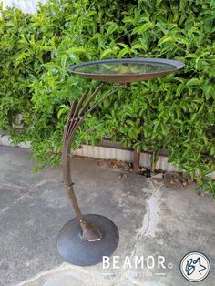 Bird bath/feeder made from plough disks and car leaf spring. Adjustable bracket to allow for change in weight distribution from feed to water. Metal Bird Bath, Metal Birds, Metal Tree, Welding Art Projects, Metal Art Projects, Metal Crafts, Metal Sculpture Artists, Steel Sculpture, Metal Sculptures