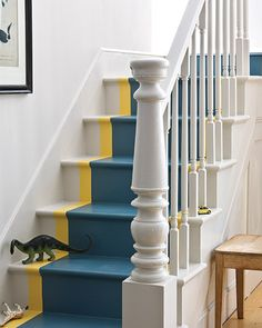 Add a bold color to a small space with a runner for the stairway
