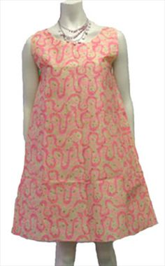 60s Vintage Disposable Paper Dress, my mom and I had mother/daughter paper dresses. They were blue and yellow.