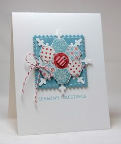 handmade Christmas card from Mama Mo Stamps ... medallion focal point ... die cut patchwork hexagon flower on top of die cut snowflake .. pinking shears edging on square .. white, pastel blue and red .. like it!!  ... Cloud9