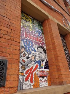 A best of Manchester mosaic outside Afflecks Palace in the Northern Quarter - Danger Mouse, Vimto and Warburtons bread!