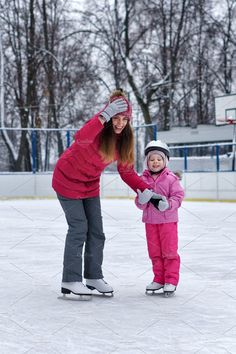 Mom teaches her little daughter to skate on the rink on a winter day. Weekends activities outdoor in cold weather. Family Stock Photo, Weekend Activities, Advertising Photography, Winter Fun, Cold Weather, Skate, Bring It On, Winter Jackets, Daughter