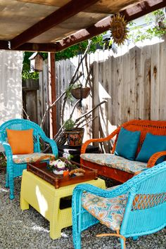 This is patio update was so easy! Some spray paint, new, colorful pillows, and some painted rocks give this gravel patio a cool Carribbean vibe. See how Camille Simmons of Planning Pretty styled this patio... on The Home Depot Blog. || @planningpretty