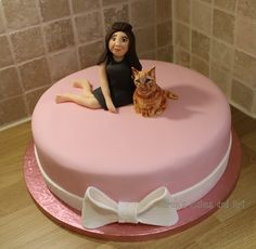 Girl and ginger tabby cat cake pink bow https://www.facebook.com/karenscakesandart