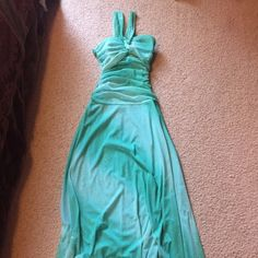 Turquoise/aquamarine Formal Evening Gown This is a beautiful gown that flows to the feet. It's a size Small and has a fitted top half. There's also some shimmer in the gown which looks beautiful and glows in any light. Only been worn once! Price is negotiable. Like, share, buy, or send me an offer! City Triangles Dresses Prom