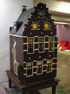 Antique doll's canal house in Museum Admiraliteitshuis in Dokkum, the Netherlands built around 1928.