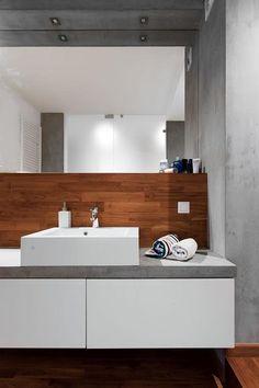 Minimalistyczna męska łazienka w drewnie i w betonie