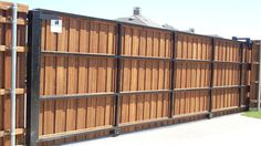 Pre-sealed cedar board on board slide gate with cap and trim. Installed by Titan Fence & Supply Company. Cedar Boards, Sliding Gate, Cedar Fence, Home Projects, Entrance, Modern Design, Backyard, Fence Ideas, Garden Ideas