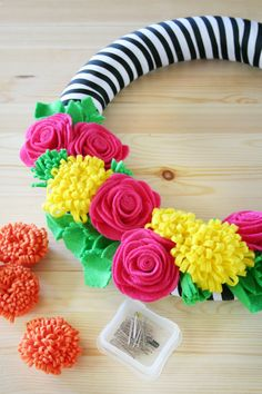 This tutorial is for a sugar skull wreath but I love the look up to this point & this is the wreath I would make. The felt flowers are great! - Amber