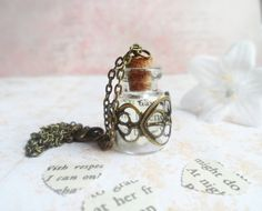 Glass bottle necklace with brass filigree and Pride and Prejudice paper heart inside, vintage inspired, Selma Dreams by SelmaDreams on Etsy