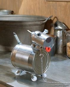 50 Jaw-Dropping Ideas for Upcycling Tin Cans Into Beautiful Household Items! 50 Jaw-Dropping Ideas for Upcycling Tin Cans Into Beautiful Household Items! Recycled Robot, Recycled Tin Cans, Recycled Crafts, Recycled Clothing, Recycled Fashion, Tin Can Crafts, Dog Crafts, Animal Crafts, Tin Can Robots