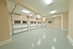 Extend your home's living space by converting your garage into a brand new space. These finished garage ideas show all of your home's untapped potential! Garage Floor Finishes, Garage Floor Paint, Garage Walls, Garage House, Garage Flooring, Car Garage, Garage Doors, Garage Studio, Garage Cabinets