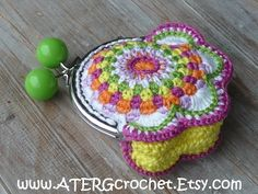 CUTE COLORFUL FLOWER PURSE FOR MONEY OR OTHER SMALL GOODS    This lovely purse is crocheted with 100% cotton in a wonderful colorcombo mandarine, fuchsia, lavendel, white, apple and citron. On top of the arc shape purse frame two candy beads in the matching color apple.    Measurements purse: 4 x 4 x 0.8 inches / 10 x 10 x 2 cm      After confirmation of your payment your cute flower purse will be color-/carefully packed for shipping.      -------------------------------------------...