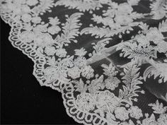 """Material: Tulle Netting embroidered with silver threaded leaf with silver sequins and haute couture inspired florals<br>Size: Approx. 54"""" x 4yards"""