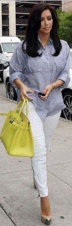 Who made Kim Kardashian's blue button down top, white skinny zipper jeans, pumps and green handbag?