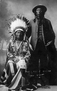"nativeskins: "" Chief Red Cloud seated and wearing a headdress, buckskin shirt and blanket over his legs; his son Jack Red Cloud stands next to him. """