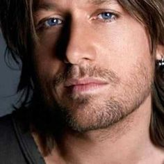 Keith Urban - thought it was the hair; could be the eyes; talented and great entertainer. What a package!