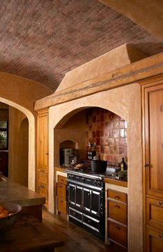Brick Ceiling + Wood + Terra Cotta Kitchen It has such a warm feeling and I love the slight arch in the ceiling.