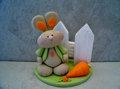 Bunny Carrot Figurine by countrycupboardclay on Etsy Cute Polymer Clay, Polymer Clay Animals, Polymer Clay Miniatures, Fimo Clay, Clay Projects, Clay Crafts, Fondant Animals, Clay Design, Clay Figures