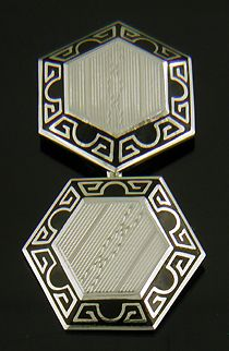 """Elegant Art Deco cufflinks with dramatic black enamel borders and pinstripe white gold centers. A nice example of the dramatic black-and-white jewels of the late and Crafted in gold, circa"