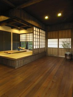 tatami room. This would be great for a dining/living room area. The tatami part can be fore the dining room where under the table there is a space for feet-Kotatsu]
