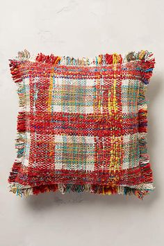 Anthropologie offers a boho take on plaid with the Woven Hanover Pillow. It's the perfect home decor accent!