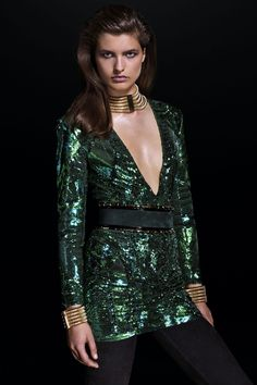 Shine confidently in a green sequin embroidered mini dress from the Balmain x H&M collection, available in select stores & online from Nov. 5th.