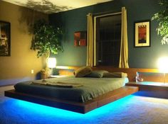 bedroom ideas with floating bed and blue LED lighting