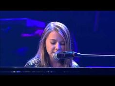 """A Young Girl Plays The Piano And Sings """"What A Wonderful World"""" With Her..."""