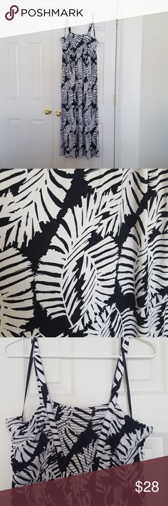 LANE BRYANT Black and White Palm Print Maxi Dress Stylosh and comfortable black and white Lane Bryant Maxi dress. Palm leaves print. Spaghetti strap. Stretchy, flowy material.   Size 14/16 Bust 38 inches unstretched  Waist 36 inches unstretched Length armpit to hem 38 inches Lane Bryant Dresses Maxi