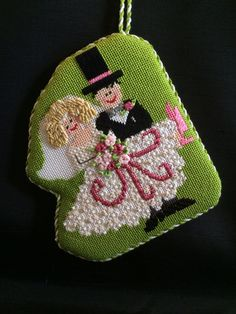 Love the stitches, princess & me needlepoint wedding ornament have for Nick and Stephanie.