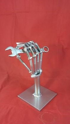 Skeleton hand made from bolts and a wrench.