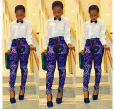 Purple African Print dressed with a white t-shippers and a bow tie, and to top it off, a beautiful African purse to look dinner/lunch worthy.