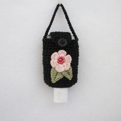 Crocheted Hand Sanitizer Holder/Cozy in Black w Pink Flower and Sage Leaves. $8.00, via Etsy.