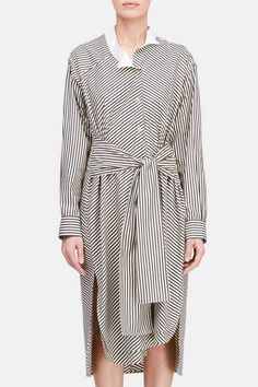 Jonathan Anderson is upholding and enlivening 170-year-old Loewe. This graphic cotton shirtdress is a feminine reinterpretation of the house's iconic asymmetric shirt. The button-front style has a white poplin wingtip collar, an attached waist tie, single-button cuffs, and a layered shirttail hem with deep side slits.