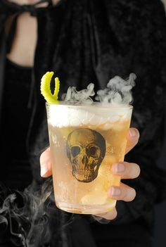 Perfect for fall and Halloween, The Grave Digger cocktail made with flavors of apple, ginger and whisky! Great for a crowd or single sipping.
