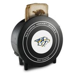 The NHL ProToast MVP Toaster boasts an eye-catching hockey puck shape with 2 slots on top and an official pro hockey team logo on the outside. It has adjustable toast settings and toasted bread comes out with your favorite team's logo. Pro Hockey, Hockey Puck, Hockey Teams, Nhl Shop, Nhl News, Columbus Blue Jackets, New York Islanders, Buffalo Sabres, Tampa Bay Lightning