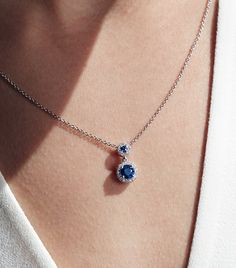 Brilliant blue sapphires are accentuated by halos of shimmering diamonds in this striking pendant set in white gold. Diamond Necklace Simple, Blue Sapphire Necklace, Gold Jewelry Simple, Sapphire Jewelry, Sapphire Bracelet, Sapphire Pendant, Blue Necklace, Pendant Necklace, Pearl Necklace Designs