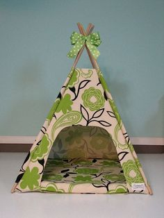 *dont have to go this far but handmade tents have got to be better than taht plastic igloo I keep seeing* Gorgeous Guinea Pig Tepee. She'd probably chew on it though.