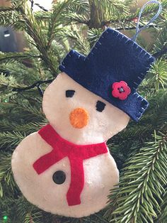 Cute little felt snowman for a Christmas decoration.