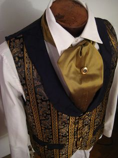 Steampunk Gentleman's Vest by dreadnoughtdesigns.deviantart.com Love the paisley print and the rich gold against black.