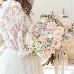 This 3D floral appliquéd #weddingdress and oversized blooming #bouquet are a picture perfect pairing. | Photography By: Atelier Dei Fiori | WedLuxe Magazine | #luxury #wedding #luxurywedding #weddinginspiration #extravagant #floral #weddinggown #bridal #gown