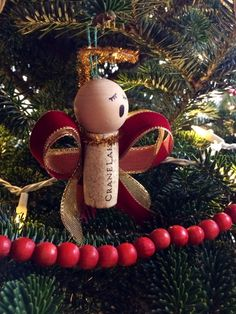 Caroling angel wine cork ornament by UncorkHappiness on Etsy